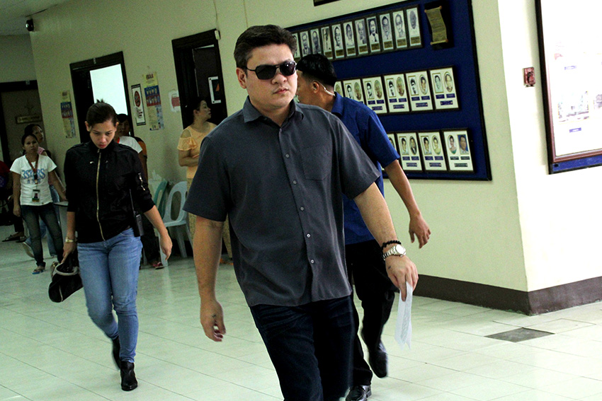 A day after attending their father's inauguration in Malacañang, Davao City Vice Mayor Paolo Duterte walks fast from his office at the City Council to attend a press conference here on Friday, July 1. He announced that City Mayor Sara Duterte is on leave until July 22. Duterte is accompanied by his security details who are members of the Presidential Security Group. (Ace R. Morandante/davaotoday.com)