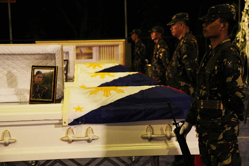 HONOR GUARDS. Soldiers stand as honor guards to the coffins of four soldiers who died in a series of offensives by the 8th Pulang Bagani Company of the New People's Army in Monkayo Town, Compostela Valley.The four soldiers are currently laid at state in Naval Station Felix Apolinario in Panacan, Davao City. (Paulo C. Rizal/davaotoday.com)