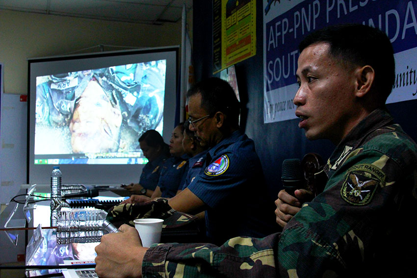 In a press conference in Davao City on Wednesday, August 10, Army spokesman of the 10th Infantry Division, Capt. Rhyan Batchar, shows a photo of one of the slain soldier in a series of offensives by the New People's Army in Monkayo, Compostela Valley.(Paulo C. Rizal/davaotoday.com)