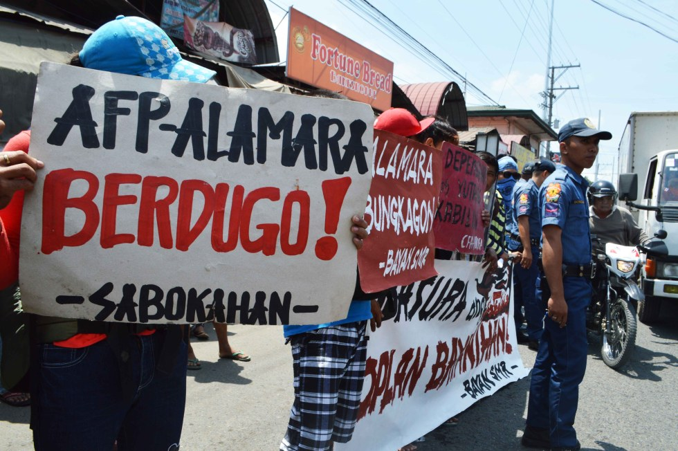Protesters rally at the Eastern Mindanao Command Headquarters.