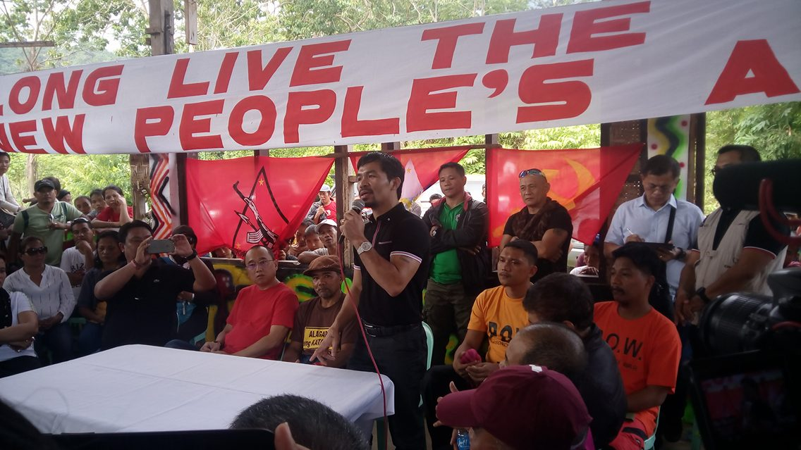 Senator Manny Pacquiao delivers a message during the release of two police officials who were held captive by the New People's Army. (Earl O. Condeza/davaotoday.com)