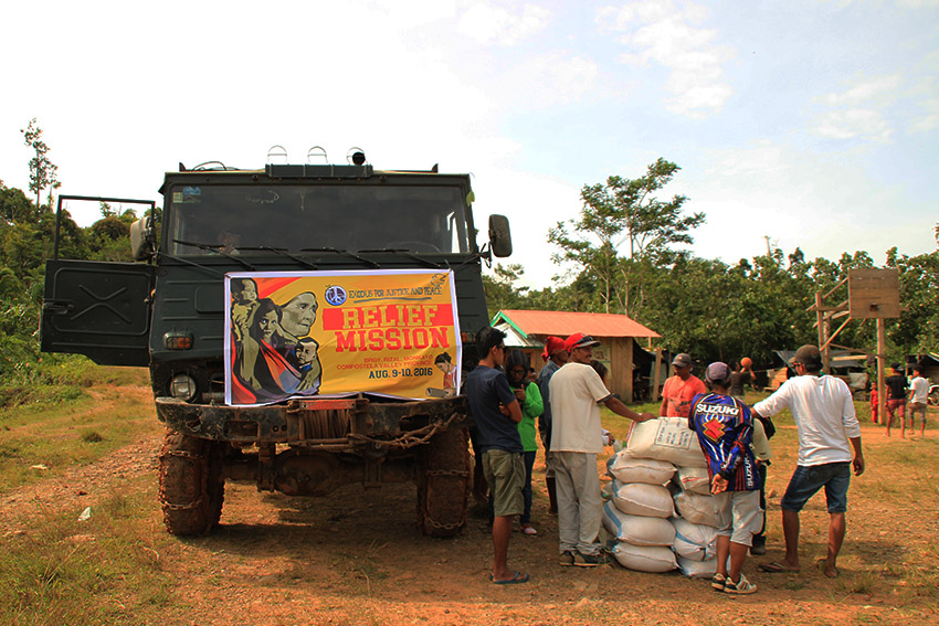 RELIEF MISSION. About 50 delegates of the relief mission, on board two trucks with food aids, travel some 7 kilometers to reach the community of Purok 4, Barangay Rizal in Monkayo, Compostela Valley province. (Earl O. Condeza/davaotoday.com)