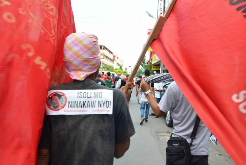 Protesters march in Davao City's main streets.