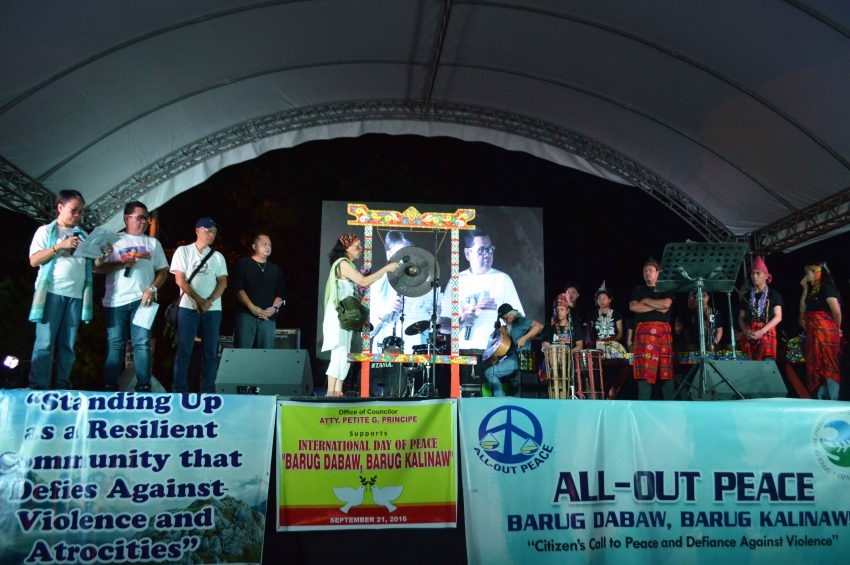 During the program, the organizers read the names of the victims of Martial Law and struck the gong for each name. (Medel V. Hernani/davaotoday.com)