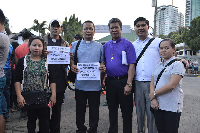 United Church of Christ Bishop Hamuel G. Tequis (4th from left) condemns the incident and urge Davao City residents to be vigilant at these times.