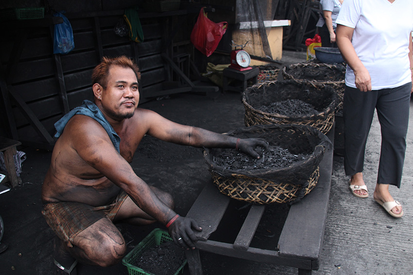 Workers like Casipi risk having pulmonary ailments as they can breathe in fine charcoal dust. They also face the danger of fire accidents that come with the goods that they sell. (Paulo C. Rizal/davaotoday.com)
