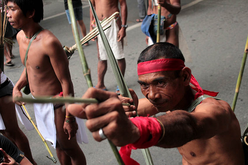 DUMAGAT. A member of the Dumagat tribe holds a bow and arrow while marching to Mendiola in Manila on Oct. 13. The Dumagat are natives of Mindoro.