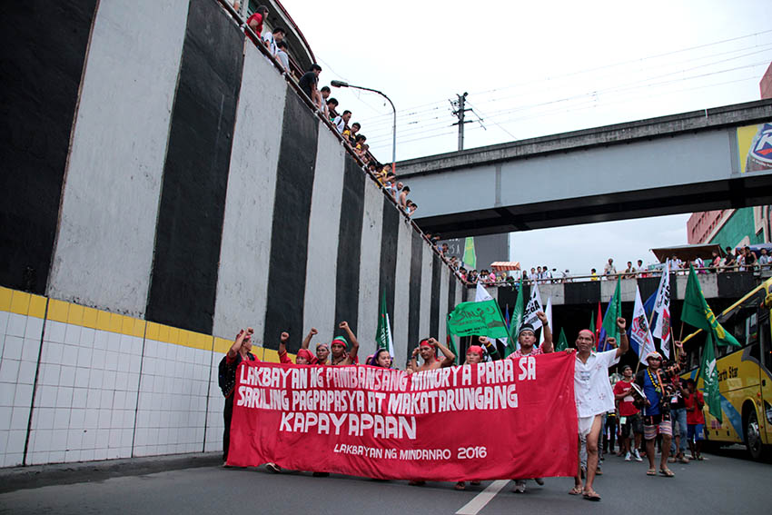 "MARCH FORWARD. Contingents of Mindanao Lakbayan are joined by their counterparts from Visayas and Southern Luzon as they march onward to Cordillera for the ""Grand Salubongan"" in Mendiola on Oct. 13."