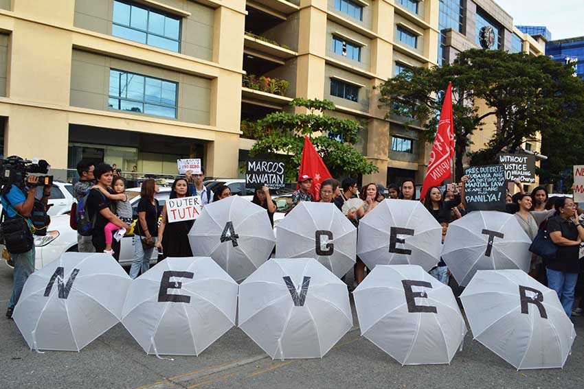 NEVER FORGET. Members of the Konsensya Dabaw, a group opposing the burial of former President Ferdinand Marcos bring their creative umbrellas to show to the public their stand on the Marcos burial issue. (Medel V. Hernani/davaotoday.com)