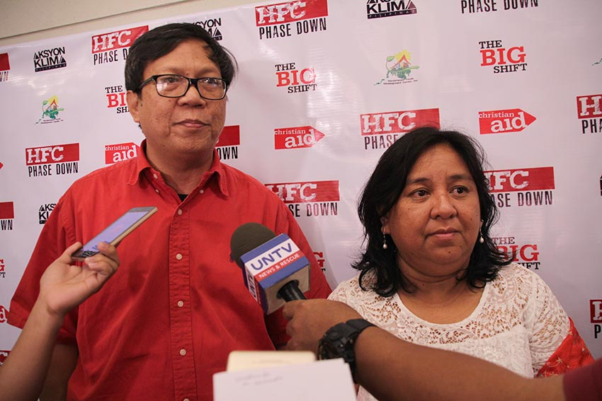 ENVIRONMENTALISTS. Renewable energy advocates Engr. Melvin Purzuelo, National Coordinator of Aksyon Klima Pilipinas (left) and Jessica Dator-Bercilla, Senior Advocacy and Policy Officer for Asia and the Middle East of Christian Aid (right) call for more public awareness regarding the dangers of Hydroflourocarbons, a type of greenhouse gas that was used as an alternative to Chloroflourocarbons, but causes bigger problem in the environment. Their groups held a forum at the Marco Polo Hotel in Davao City on Wednesday, Dec. 28. (Paulo C. Rizal/davaotoday.com)