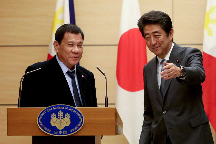 President Rodrigo Roa Duterte and Japan Prime Minister Shinzō Abe share a light moment during the declaration of joint statement following the expanded bilateral meeting at the Prime Minister's Office in Japan on October 26. REY BANIQUET/Presidential Photo