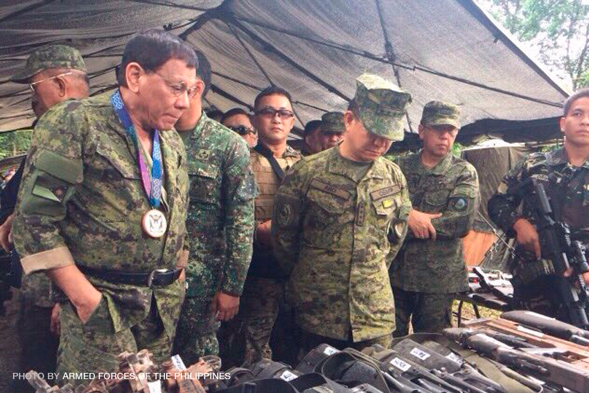 Duterte visits troops in Marawi on Day 58