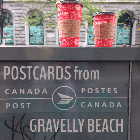 Postcard from Gravelly Beach – Grey Canada Post box, white letters