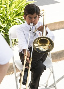 Young violinist tries out the trombone at the Page Youth Center BRAVO! concert 4/29/17