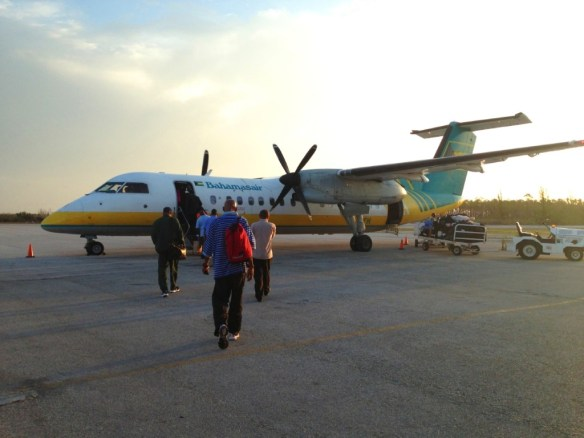 The sunrise outlined the still propellers of our well-aged Dash 8.