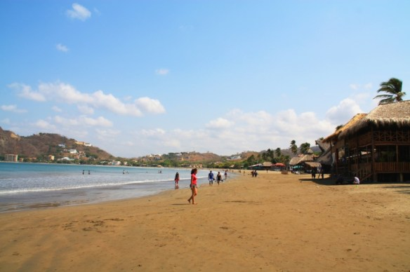 Locals and tourists alike enjoy the beach at San Juan del Sur.