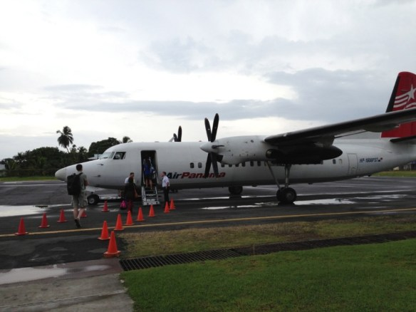 Boarding our Panama Air Bombardier Dash 8.