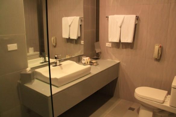 Sleek stylish bathrooms with glass door showers.