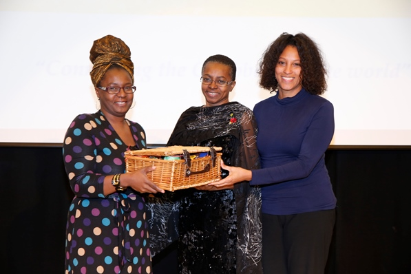 Mrs Carol Vaughan-Roberts, administrative director for CaribDirect and Mrs Nyree Chambers of Grace Foods UK presenting Mrs Doris Charles her gift basket. Photo courtesy CaribDirect