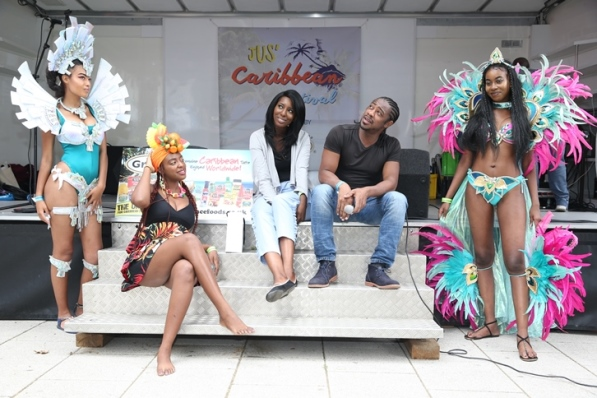 MC Kat Boyce relaxes with Trinidadian beauty queens at Jus' Caribbean Festival. Photo courtesy CaribDirect