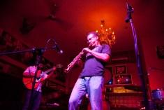 photo of David Sills on stage playing at Bali Mannekenpis