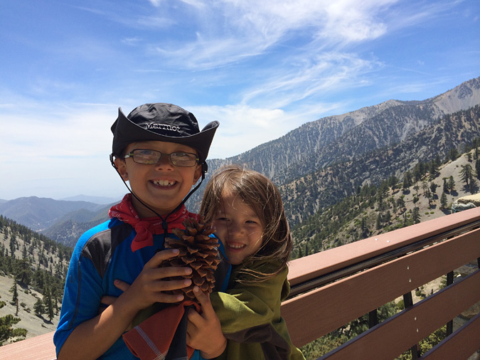 """Waiting for lunch at the Top of Notch. Enzo is holding """"Mr Pinecone"""", who apparently was whispering secrets of the mountain to the kids all afternoon. I didn't hear him say anything though."""