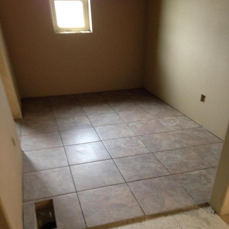Tiling in the shoe/mud room