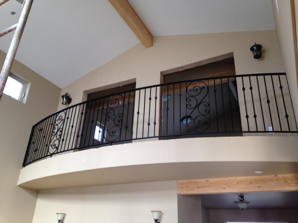 Custom metal railing goes on the curved balcony edge.