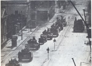 A Black & White photo of tanks rolling in the streets of Greece