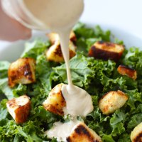 Kale Caesar Salad with Non-Dairy Tahini Caesar Dressing and Pretzel Croutons