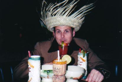 The Jab sampling Trader Dick's drinks, 2001 - all the mugs came with the drinks then, even the hat, which comes with the Cha Cha!
