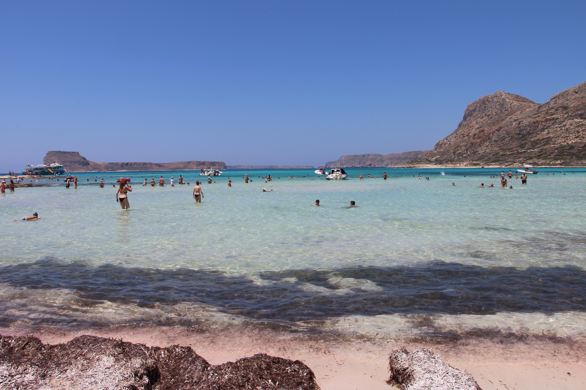 Pink and white sand and aqua waters at Balos Beach Lagoon in Crete.