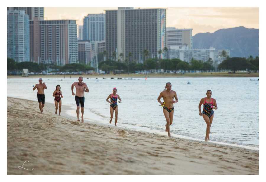 people jogging along ala moana beach