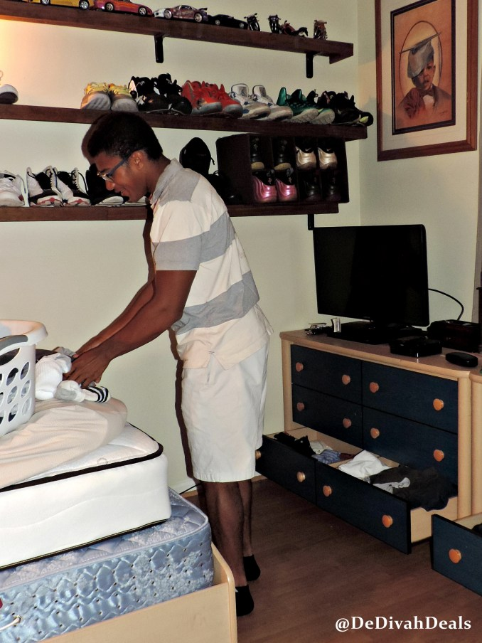 Son folding and putting away his laundry