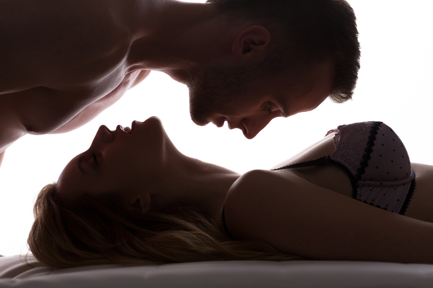 Sexy love couple in bed having foreplay