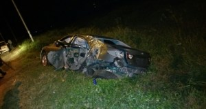 The badly damaged car that was being driven by  a policeman.