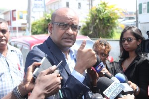 Opposition Leader, Bharrat Jagdeo speaking with the media shortly before voting in the 2015 Local Government Elections.