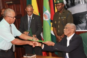 Rupert Henry Smith talking the Oath of office as Mayor of Mabauma before President David Granger on Wednesday, April 7, 2016.