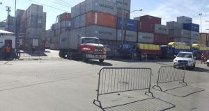 City Police erected barricades outside Muneshwer's Wharf , Water Street to prevent laden shipping containers from leaving or entering the wharf unless a levy of GYD$25,000 is paid.
