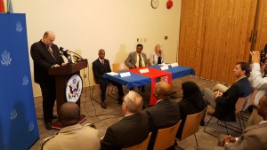 US Ambassador to Guyana, Perry Holloway at the podium. Others at the table are (left to right)  United States  State Department's International Narcotics and Law Enforcement Coordinator for Guyana, Leon Carr IIPublic Security Minister, Khemraj Ramjattan and Justice Education Society Programme Manager in Guyana, Evelyn Neaman.