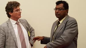Britain's High Commissioner to Guyana, Gregg Quinn (left) and Minister of Public Security, Khemraj Ramjattan speaking recently at the American Embassy   before the launch of the US-funded Justice Education project.