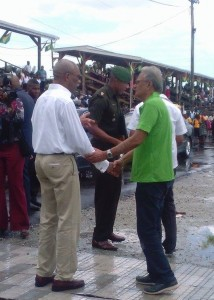 President David Granger and Minister of Education, Dr. Rupert Roopnaraine greet each other at D'Urban Park during the Education Month Rally.