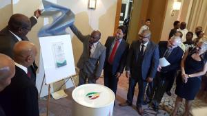 Foreign Affairs Minister, Carl Greenidge and GOGA Director, Nigel Hughes unveil the association's logo at Marriott Hotel.
