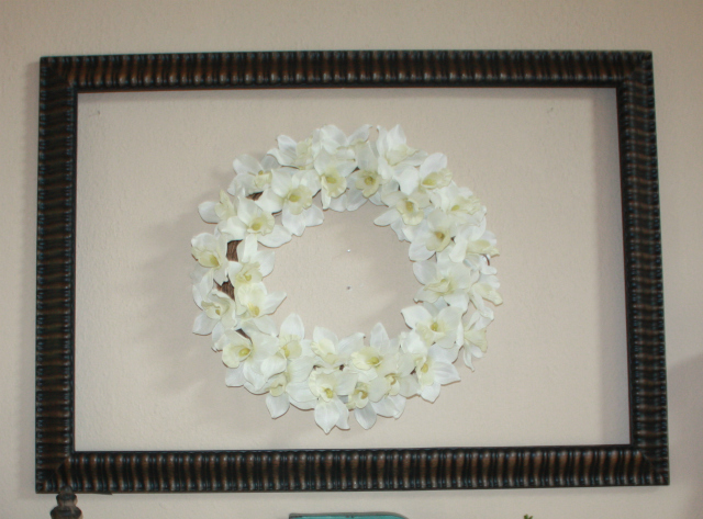 swing into spring mantel wreath