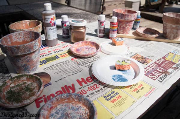 using sponges to  paint flower clay pots