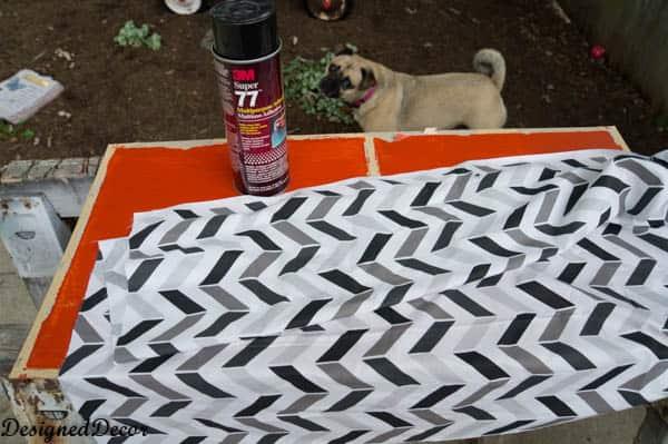 adding fabric to the backs of shelves