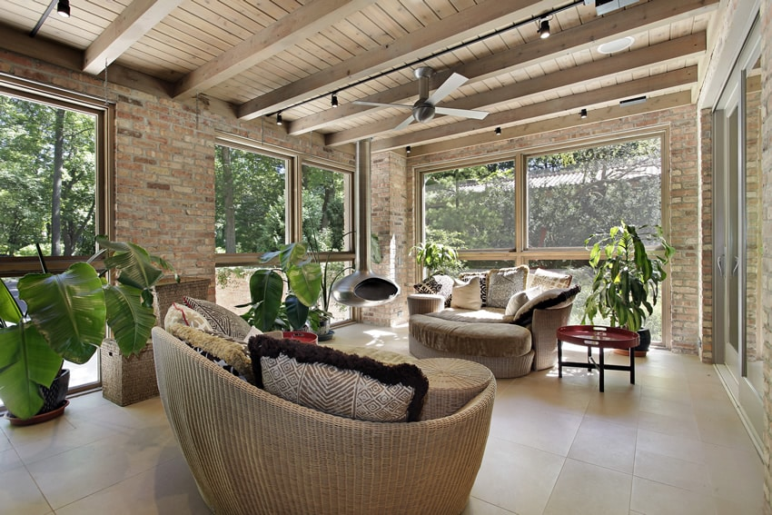 brick sunroom with wicker furniture for n