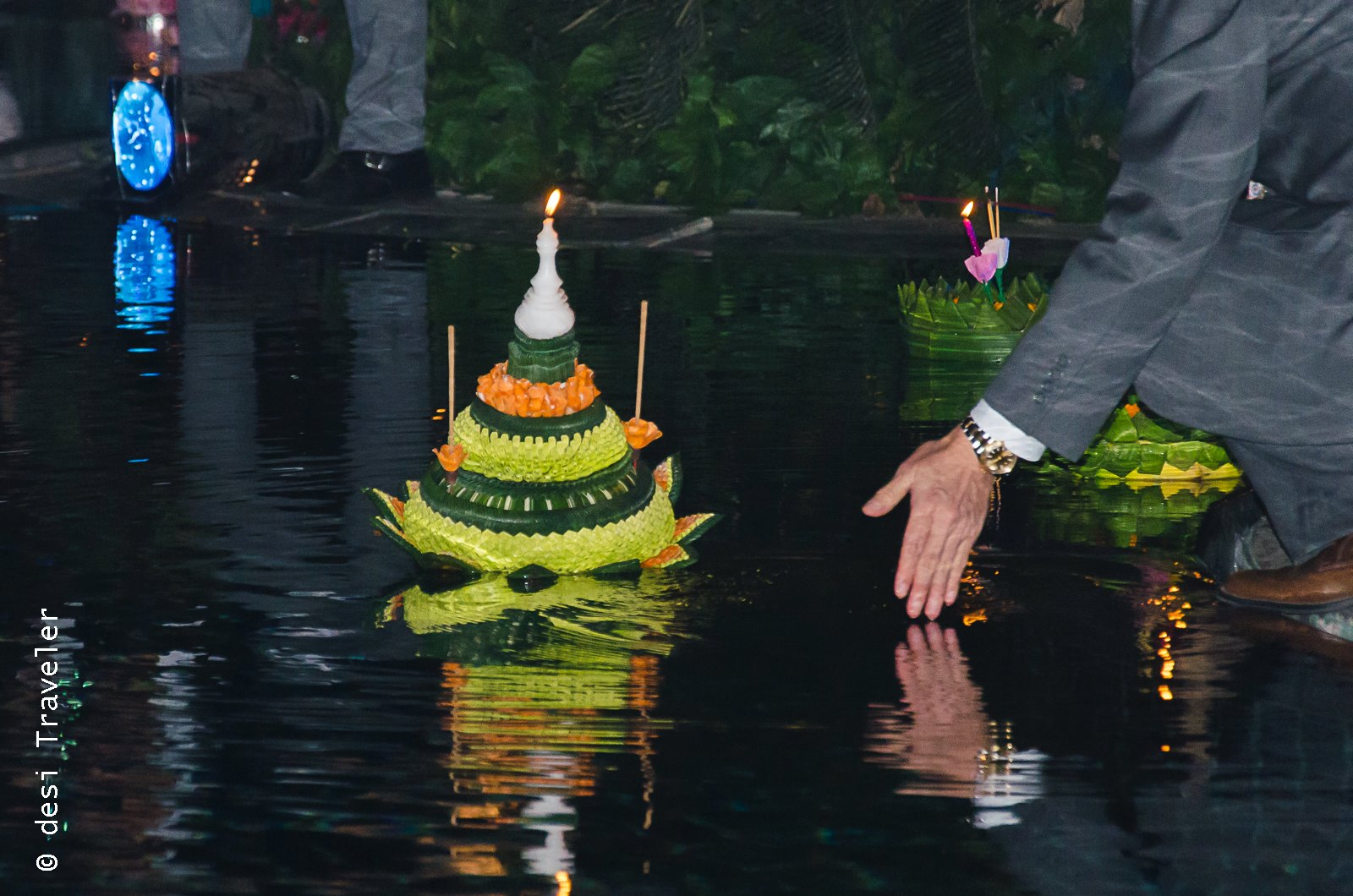 a man floats Loi Krathong