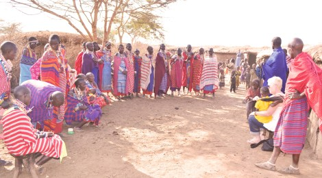 Co-owner of Matonyok, Mary Argimon discusses business plans with a Maasai tribe near Amboseli, Kenya.