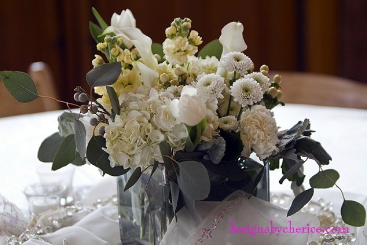 Hydrangea,roses, cremone, mini callas, tulips, button mums, hypericum berries, dusty miller and seeded eucalyptus